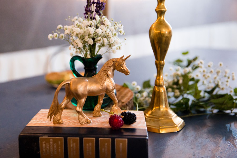 Gold unicorn wedding decor